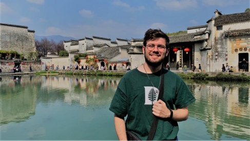 Gui in front of a manmade lake in Anhui province, China