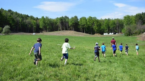 Upper Valley children running with a Dartmouth Student mentor