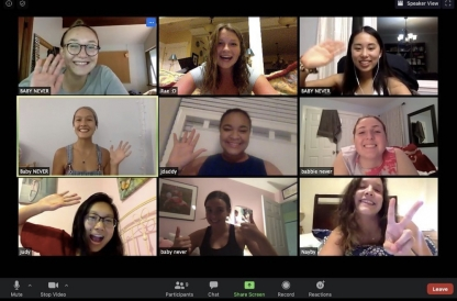A screenshot of 9 women waving at each other on Zoom.