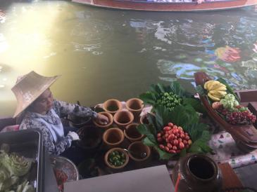 A vendor at the Bangkok floating market