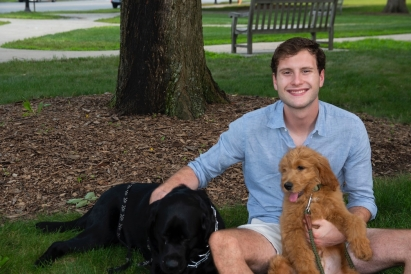 Blog author sitting with two dogs
