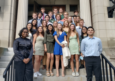 Angie and her freshman floor standing on the steps of Parkhurst Hall during Matriculation 2021. Everyone is wearing formal wear.