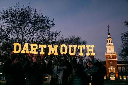 """""""dartmouth"""" spelled out in lighted letters in front of Baker Berry"""