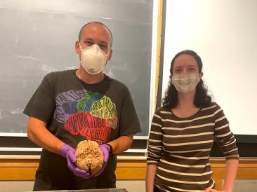 Professor S. Winter Holding a Brain