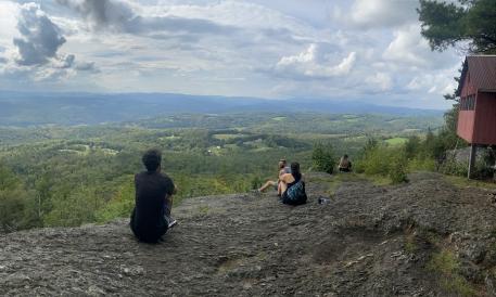 Gabriel Gilbert's friends sitting on Wright Mountain, VT
