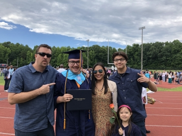 Gabriel Gilbert and family at graduation