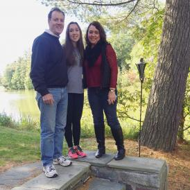 colleen and her parents outside the Dartmouth Outing Club House on Occom Pond