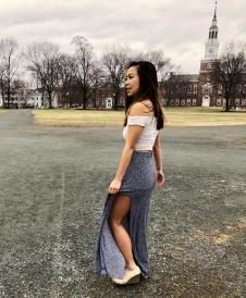 Student twirling on the campus green