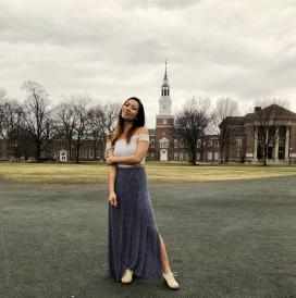 Female student standing on the campus green