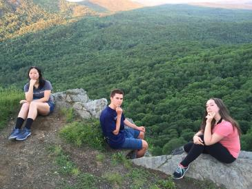 Colleen and friends pensive on a mountain