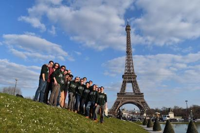 The Dartmouth Aires standing in front of the Eiffel Tower