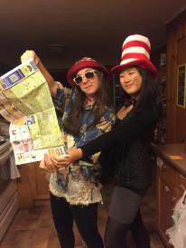 Colleen and a friend dressed in flair pretending to look at a map