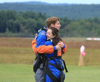 Colleen and a friend hugging to celebrate that they survived!