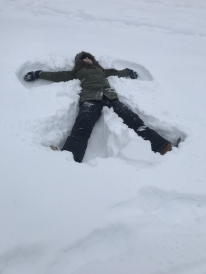 Colleen making a snow angel on the golf course