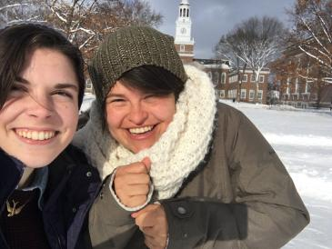two young women in winter on the green