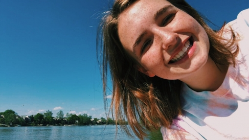 Abbi taking a selfie with a river in the background