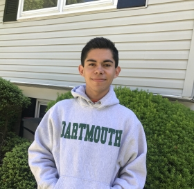 Robin posing wearing a dartmouth sweatshirt