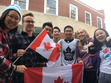Shuyi and friends posing with the Canadian flag.