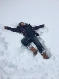 woman lying in snow