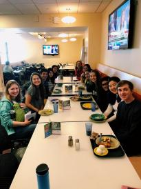 group of students at long table in dining hall