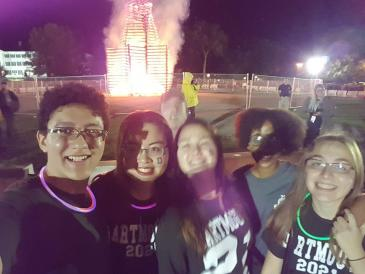 Autumn with friends at Homecoming bonfire