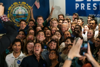 President Joe Biden surrounded by a crowd of Dartmouth students, all smiling