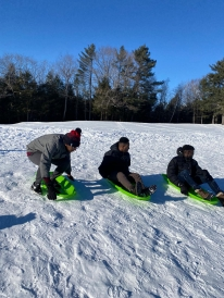 Dartmouth students skiing at the golf course