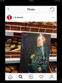 "book (John Bright: Statesman, Orator, Agitator"") in front of bread shelf"