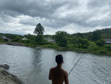 Azariah Javillonar '23 fishing on the River
