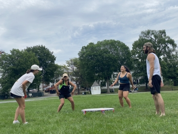 Spikeball game on the Green