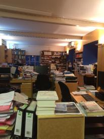office with books piled everywhere