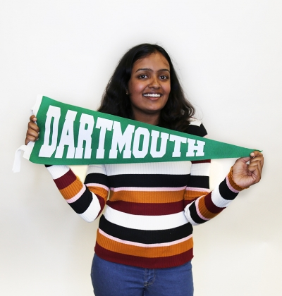 Female student holding a Dartmouth pennant posing for portrait
