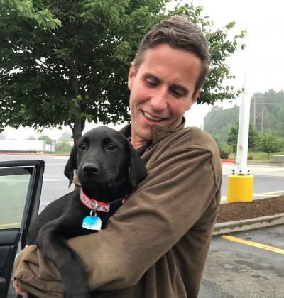 Topher holding his puppy