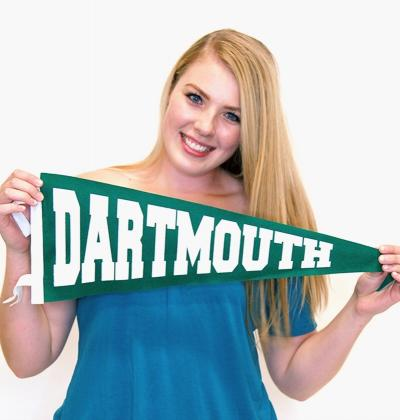 blonde woman in blue shirt holding Dartmouth pennant