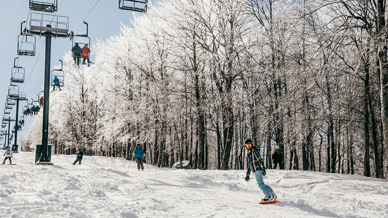 A photo of students skiing and snowboarding at the Dartmouth Skiway