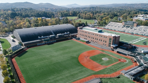 A photo of Dartmouth's baseball field with the mountains in the background