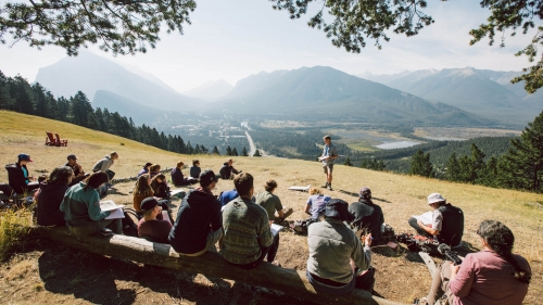 Associate Professor Erich Osterberg leads a class at the Mount Norquay Overlook above Banff.