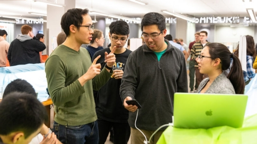Students check out new technology and design work created by students in the DALI Lab and the Computer Science Department at the Technigala conference hosted by DALI in March.