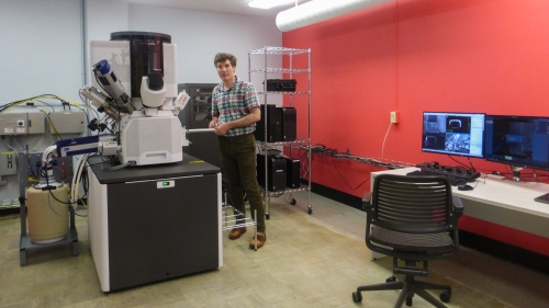 Maxime Guinel, director of the Electron Microscope Facility, shows off the state-of-the-art scanning electron microscope, which lets scientists see under the surface of the materials they study.