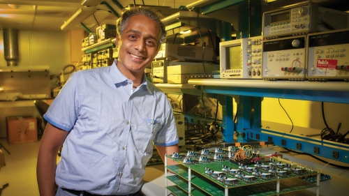 """""""I love the sizzle in the brain created by an invention that solves a problem you have been working on intensely,"""" Professor Rahul Sarpeshkar says. (Photo by John Sherman)"""