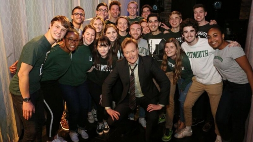 Conan O'Brien surrounded by students in Dartmouth shirts