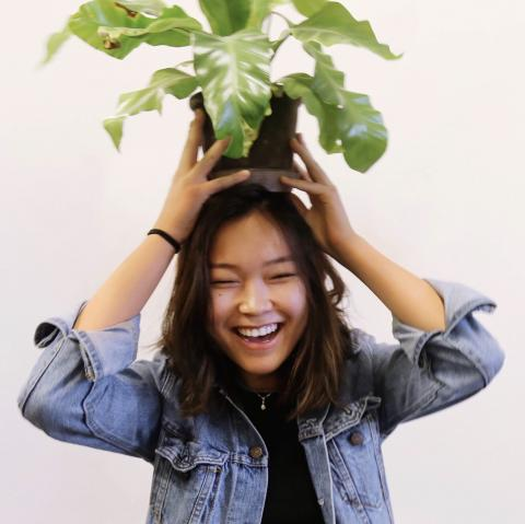 Cindy with a plant on her head