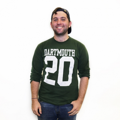 Student smiling for a portrait wearing Dartmouth t-shirt