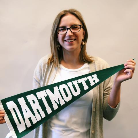 Isabel holding Dartmouth pennant