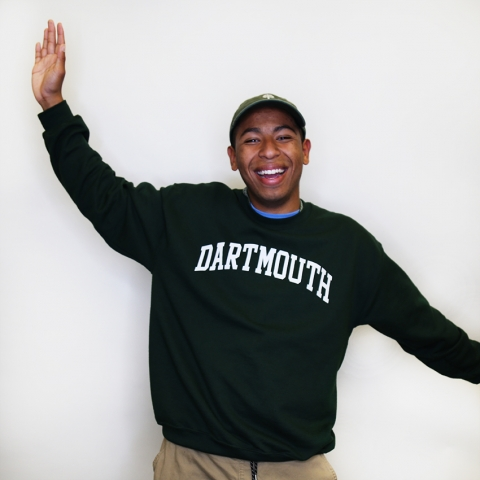 Tulio smiling with Dartmouth sweatshirt