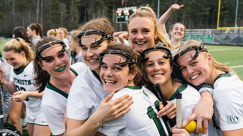 A photo of the women's lacrosse team celebrating after a game