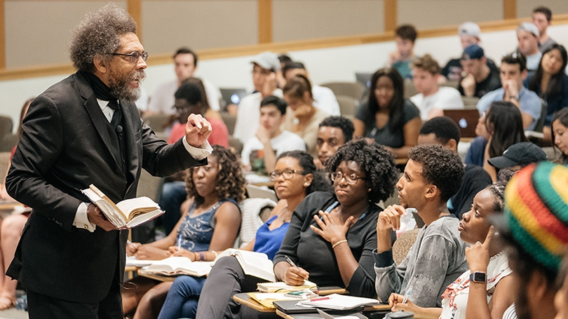 Cornel West delivering a lecture to students in a classroom