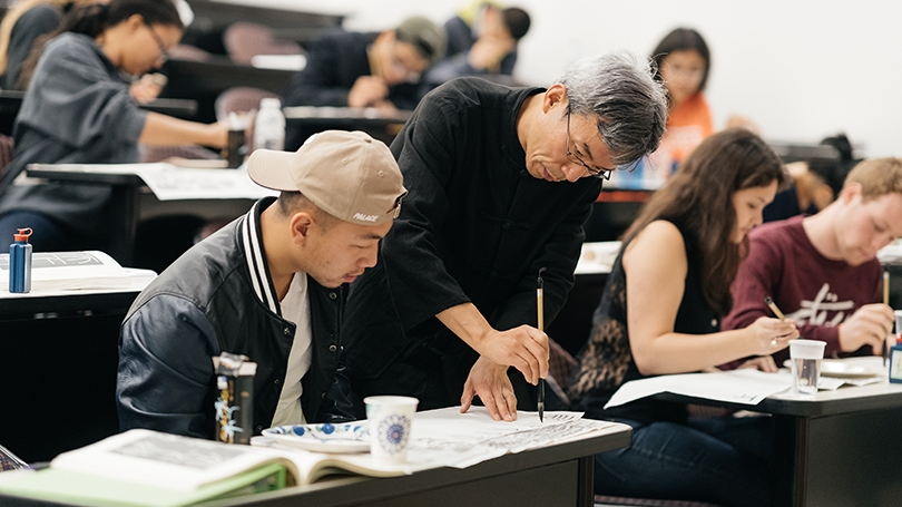Professor Wen Xing working with a student