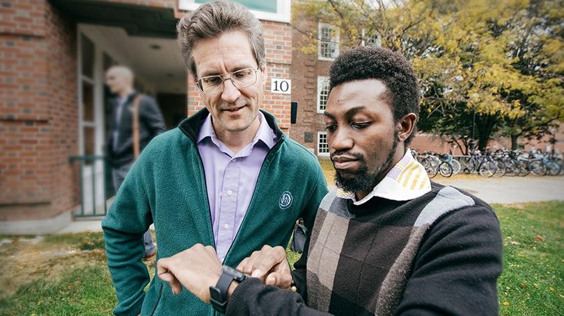 Professor David Kotz '86 (left) and George Boateng