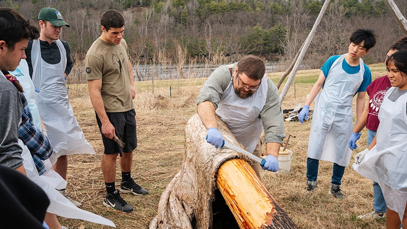 "Art Hanchett, center, demonstrates how to process a moose hide in an ""Encountering Forests"" lab."
